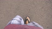 Walking Looking Down at Flip Flops. view racks focus from stomach and shirt down to feet walking on concrete with flip flops Dostupné videozáznamy
