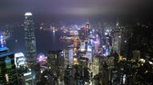 Aerial View From Flying Drone Of Hong Kong City Residential Tall Buildings at Night.