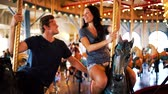 carrossel : romantic couple riding carousel together Stock Footage