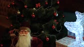 weihnachten : Santa Claus toy under the Christmas tree Stock Footage