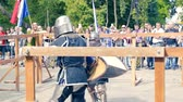 armored : Ukraine, Kharkov August 24, 2017: Full HD Video. Knight tournament among professionals and amateurs. Combat in swords in heavy armor
