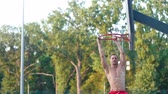 coup de pouce : A player in streetball makes a slam dunk. Basketball training outdoors in the park. Healthy lifestyle. Video in full hd format.