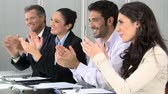 aplauso : Happy smiling business team clapping hands During a meeting. Happy colleagues applauding at conference meeting.