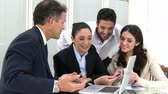 group : Businesspeople at working meeting with the leadership. Happy business team discussing and working together at office meeting with laptop. Stock Footage