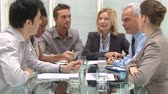 Group Of Coworkers Discussing In Conference Room. Business meeting on a modern office. Business teamwork in a meeting room for a new deal. Colleagues working together a new financial budget.