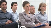 aprendizagem : Business group of people attending an educational presentation. Businessmen and businesswomen are concentrated listening to the business conference. Businesspeople sitting at the business meeting.