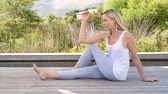 fitness : Smiling senior woman stretching and exercising outdoor. Senior relaxed woman doing yoga stretches after exercise. Beautiful woman relaxing with yoga pose. Stock Footage