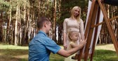 perceive : Happy family in forest walking and painting