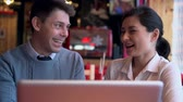 flirting : Two people in cafe surfing the internet Stock Footage