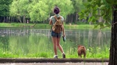 pet : Young woman with a dog by a lake