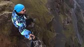 lookingdown : A hiker dangles his feet over the edge of a cliff