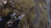 lookingdown : A hiker dangles his legs over the edge of a rock