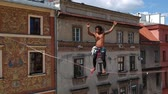 overcome fear : Brazilian Highline walker at sunny weather Stock Footage
