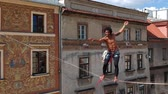 overcome fear : Highline walker at sunny weather in old city