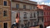 overcome fear : Slackline walker at sunny weather in a city