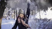 floco : Happy young woman pulling the snowy branch of tree over her head. Winter, sport, holidays, relationship, love, xmas, lifestyle concept. Filmed on cinema camera, 10 bit color space.