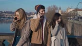 érv : People standing on street and arguing on phone. Social problem, conflict, diversity, relationship,buisness, job concept. Filmed on REd 4k, 10 bit color