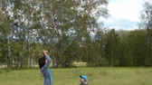 Young mother with little kid spending active leisure outdoor and flying kite in the woods. Family fun Stock Footage