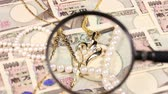 takı : Japanese yen bill and magnifying glass and jewelry Stok Video