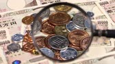 magnifying glass : Japanese yen bill and magnifying glass and coins