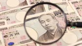 Банкнота : Japanese yen bill and magnifying glass
