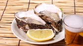 aperitivos : Fresh oysters and glass of beer Stock Footage