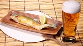 blind : Grilled japanese sweetfish and glass of beer