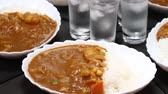 curry : Curry rice and glass of water reflecting in the mirror Stock Footage