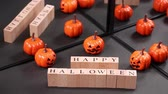 Хэллоуин : Halloween pumpkin ornament and alphabet block reflecting in the mirror