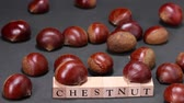 list : Fresh chestnuts and wooden block with CHESTNUT