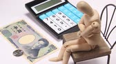 houten mannequin : Tax calculation image, calculator and cash and wooden doll
