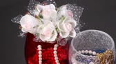 necklace : Jewelry in glass and rose bouquet Stock Footage