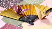 Japanese folding fan with paper crane
