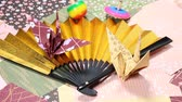 Japanese folding fan with paper crane and spinning top Wideo