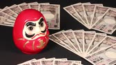 10000 Yen bills and Dharma doll
