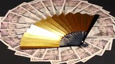 10000 Yen bills and golden folding fan
