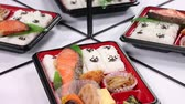 отраженный : Bento Box of grilled salmon reflecting in the mirror Стоковые видеозаписи