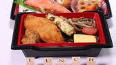 zalm : Makunouchi Bento and seaweed bento (Japanese lunch box)
