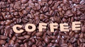 étvágygerjesztő : Coffee Beans and COFFEE Letters Stock mozgókép