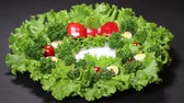 hard boiled eggs : Vegetable Christmas Wreath on black background