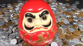 uzun ömürlü : A lot of Japanese coins and Daruma doll.  Character Meaning Longevity Stok Video