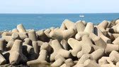 синий : Tetrapod breakwaters in sea water and fishing boats Стоковые видеозаписи