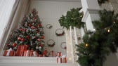 Decorated Christmas room with beautiful pine tree Стоковые видеозаписи