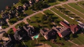wealthy : aerial shot of lavish lakefront houses Stock Footage