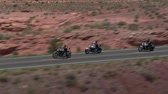 jezdec : aerial shot of three motorcycles on Monument Valley Highway