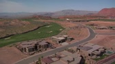 wealthy : Aerial shot of Mansions on desert golf course Stock Footage