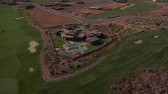 wealthy : Aerial shot of desert golf course mansion- high altitude