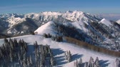 típico : aerial shot of big and little Cottonwood canyons Utah Stock Footage
