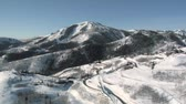 горная вершина : aerial shot of ski area and luxury homes