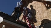 pirzola : men climb down ladder on house construction